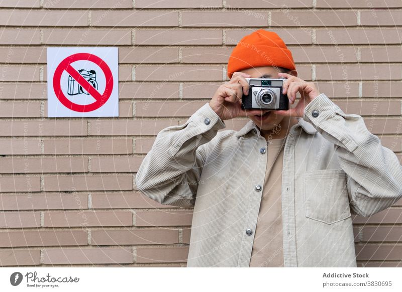 Man taking photos in restriction area man take photo violation break rule disobedience noncompliance rebel photography sign conformity device memory