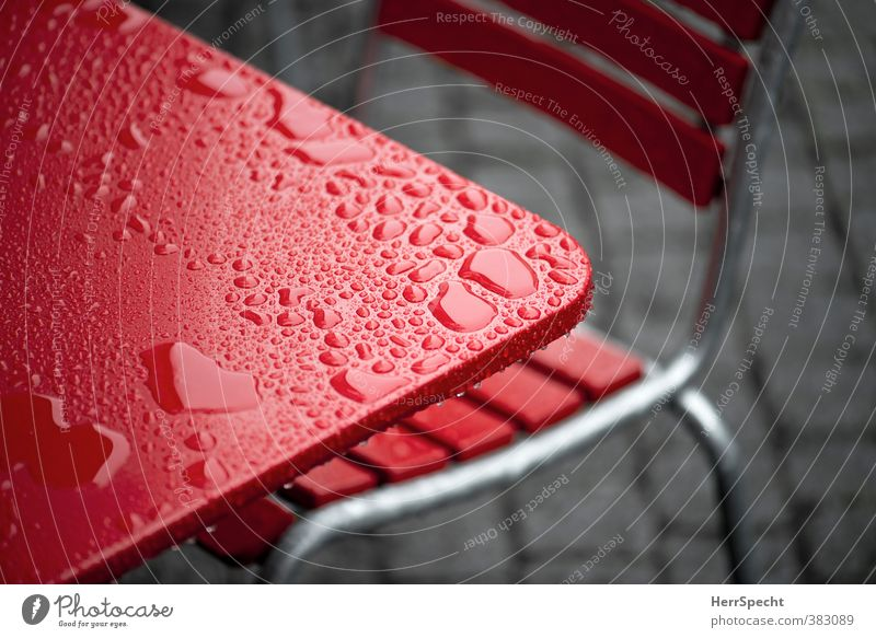 After the rain Chair Table Restaurant Town Cold Wet Gray Red Café Sidewalk café Drops of water Water puddle Tabletop Colour photo Exterior shot