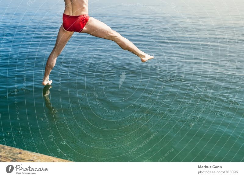 Human being Man Water Summer Relaxation Red Adults Life Movement Coast Sports Swimming & Bathing Lake Legs Jump Feet