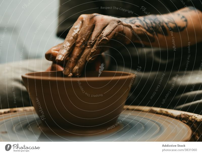 Crop ceramist making pot on clay wheel pottery workshop craftsman create maker handmade skill hobby occupation artisan handicraft tool small business ceramic