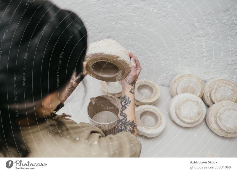 Crop ceramist making clay pot in workshop pottery pour ceramic artisan craft craftsmanship studio material handmade skill creative occupation bowl handicraft