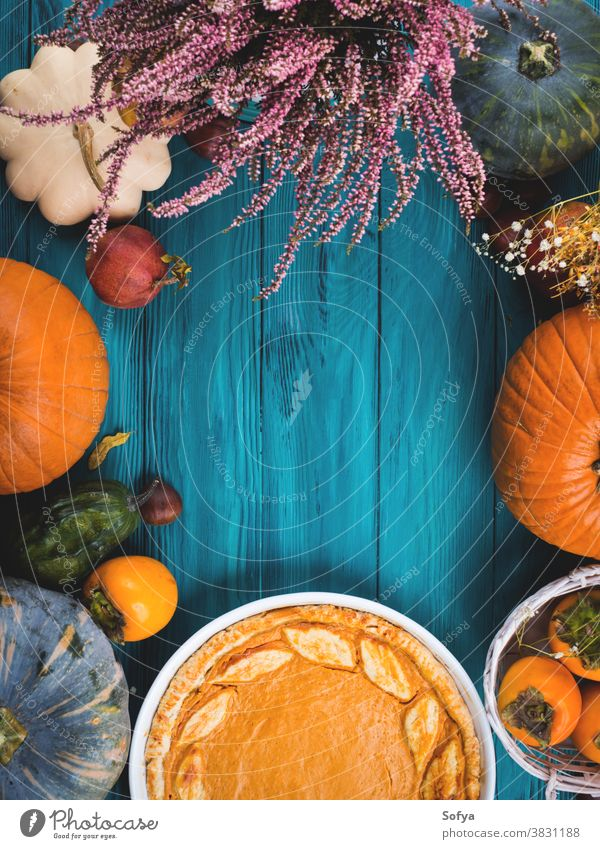 Autumn thanksgiving background with pumpkin pie autumn table sweet cake dinner flatlay wood rustic card celebration composition concept orange bake halloween