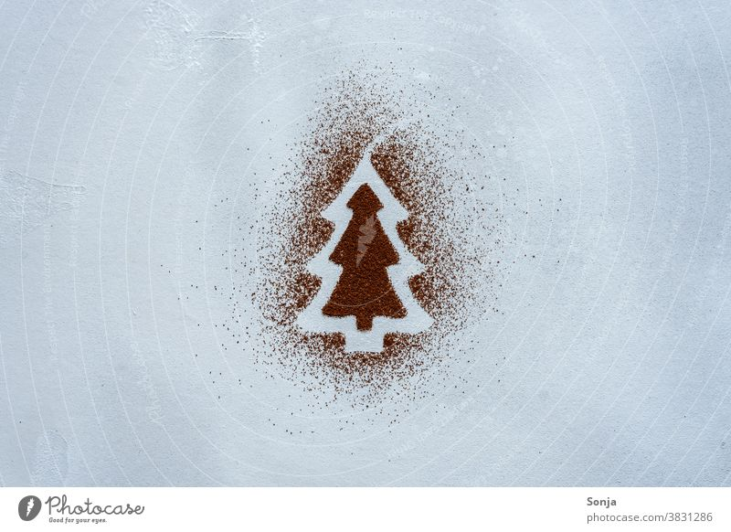 A Christmas tree made of cocoa powder on a grey background. Top view. Draw Creativity Creative concept Art Leisure and hobbies plan Painting (action, artwork)