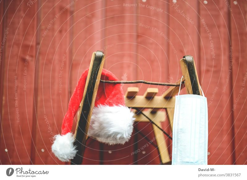 Wintertime - sleigh and Santa Claus cap and always with the mouthguard / breathing mask Christmas corona Santa Claus hat Sleigh pandemic coronavirus