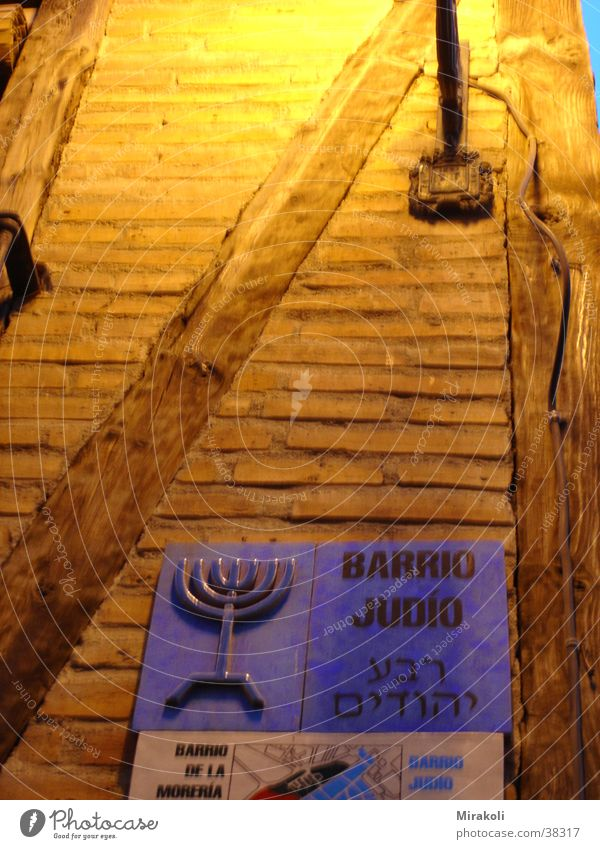 Signs and labeling Historic Spain Brick Judaism Night shot Half-timbered facade Jewish Quarter Hebrew Menorah-im