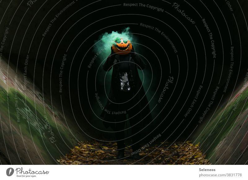 Jackhead Hallowe'en Pumpkin pumpkin head Creepy Human being Dark Smoke Colour photo Autumn Exterior shot Fear Pumpkin time Day Threat Creativity Grimace Graven
