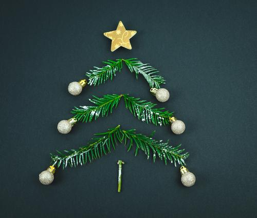 Christmas tree with star and balls made of pine branches on a black background. Copy space. decoration christmas end of the year space copy christmas tree