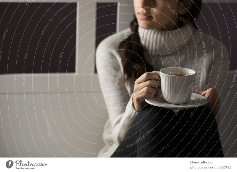 Girl holding a cup of tea adolescent bedroom beverage close up concept drink female from above fruit girl health healthy home indoor lifestyle liquid moment one