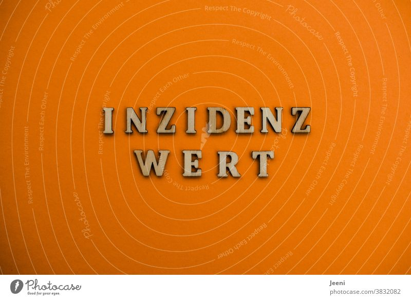 "Letters with the word ""incidence value"" - background orange Incidence value Word Letters (alphabet) corona Virus Quarantine coronavirus pandemic Epidemic"
