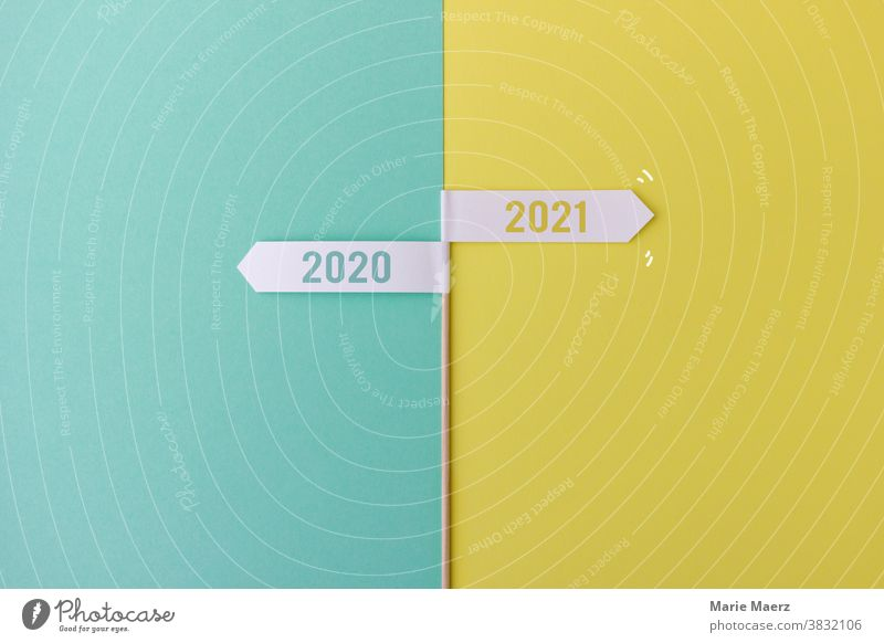 Sign at the turn of the year 2020/2021 Signs and lettering sign Arrow Future Past New Year's Eve December January Changes Laws Signs and labeling Road marking