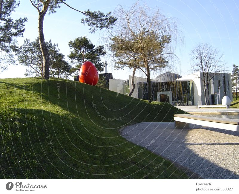 Red egg in the green Easter egg Park Obscure Egg Modern Architecture