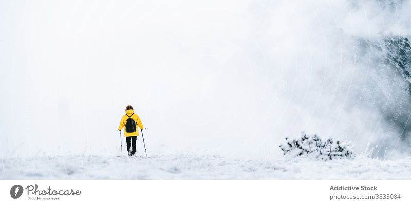 Unrecognizable traveler in mountains in winter snow trekking hike pole nature highland mountaineer pyrenees mountains andorra hiker adventure landscape explore