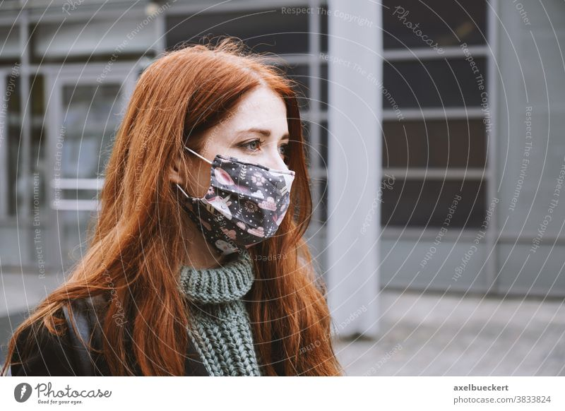 young woman wearing homemade everyday cloth face mask outdoors in city real people lifestyle corona winter authentic community mask coronavirus covid covid-19