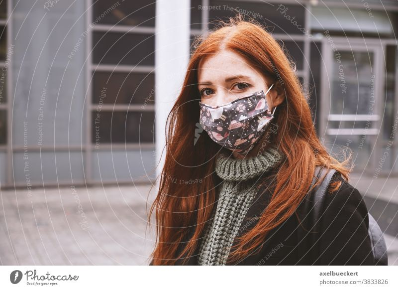 young woman wearing everyday cloth face mask outdoors in city everyday mask community mask real people lifestyle corona winter coronavirus covid covid-19