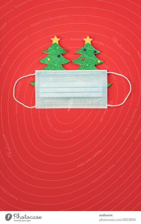 Merry Christmas.Christmas concept background.Christmas tree with protective surgical mask christmas santa claus coronavirus christmas tree banner