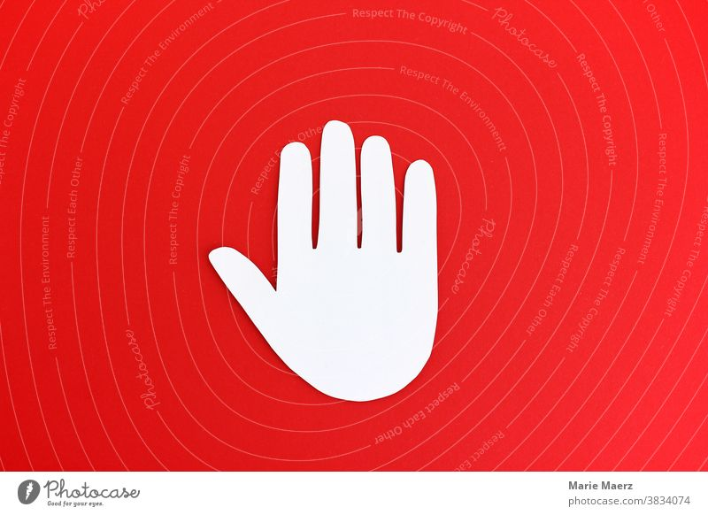 Stop! Stop-hand made of paper on red background stop Stop sign interdiction Prohibition sign Sign Symbols and metaphors Hand peril Warn Clue Warning label