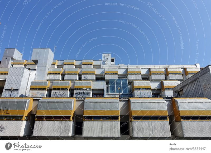 A building against a blue sky brutalism Concrete House (Residential Structure) Building Sky Industry Yellow Blue sky Wall (building) Sharp-edged Architecture