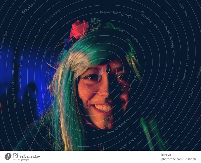 Laughing, young woman with a painted face and colorful, long hair. Portrait Face portrait Facial painting Beauty & Beauty Smiling long hairs young adults