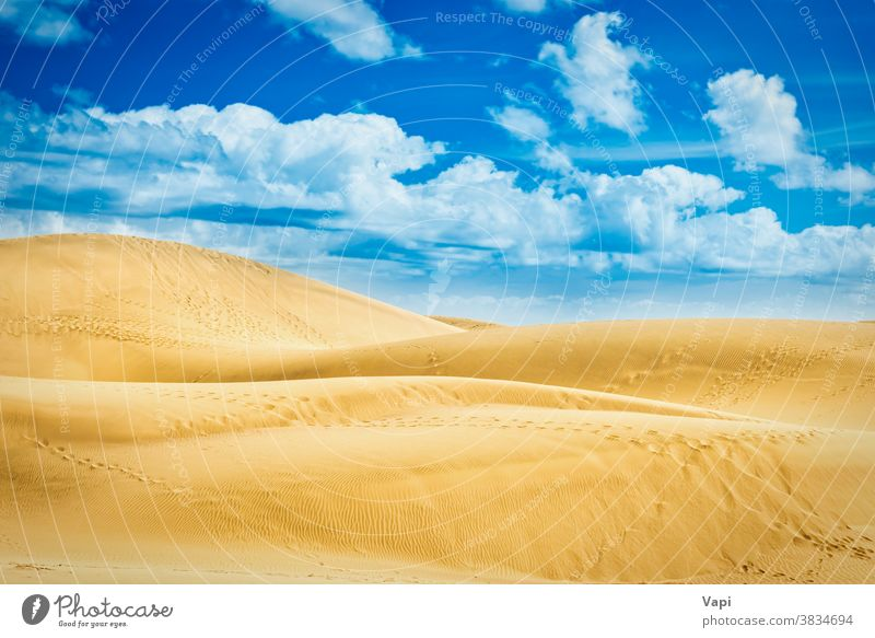 Desert with sand dunes and clouds on blue sky desert hills natural landscape reserve canary maspalomas gran canaria spain nature travel summer atlantic beach