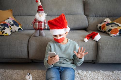 Little kid making a video call on Christmas alone celebration chat child childhood christmas computer concept corona coronavirus covid covid19 device distance