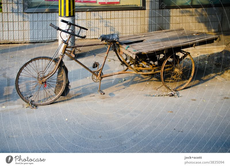 secured used load wheel Bicycle Tricycle Freight bike rusty Decline Nostalgia worn-out Parking lot Means of transport Logistics Retro Past Old Chinese