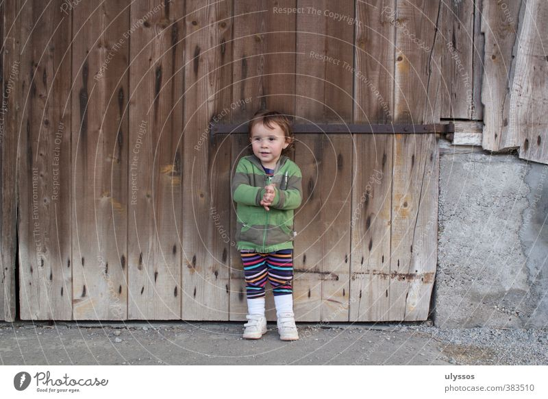 Now it's time to spit in the hands again. Child Concrete Wood Stand Friendliness Happiness Happy Brown Multicoloured Gray Contentment Colour photo Exterior shot