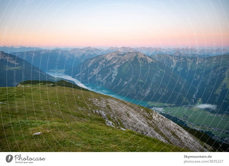Early in the morning it is most beautiful on the mountain Alps Mountaineering Hiking early in the morning Sunrise morning mood achenkirch useless front user