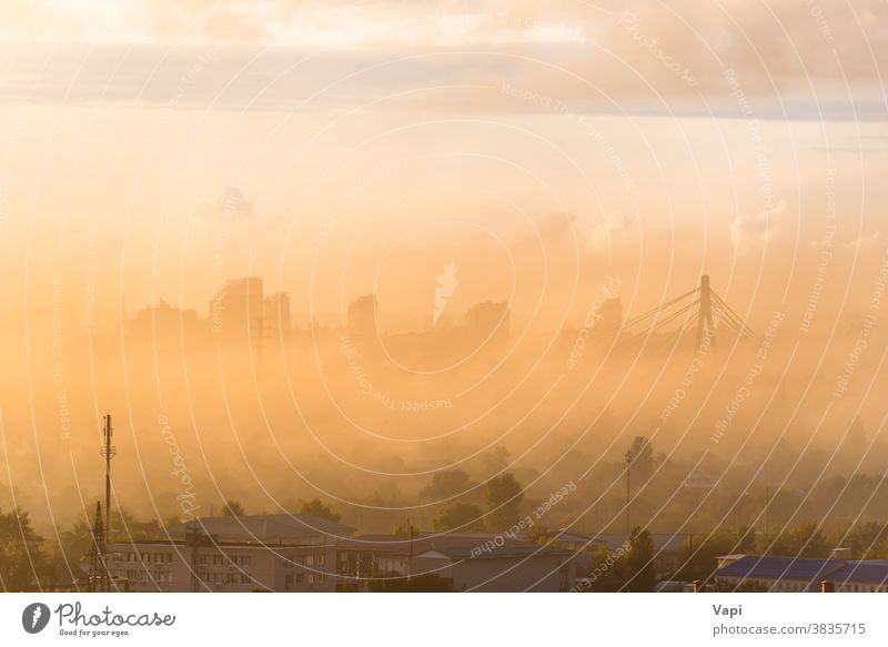 Sunset in city with fog sunset skyline urban building downtown mist clouds view architecture cityscape skyscraper landscape dusk tower business sunrise travel
