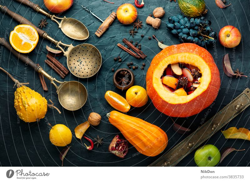 Mulled wine in pumpkin mulled mulled wine autumn alcohol drink autumn drink fall hot holiday spice orange red beverage winter anise warm seasonal drink cinnamon