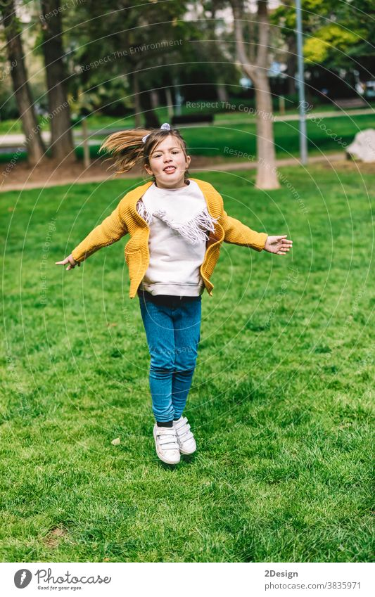 Beautiful little girl jumping over the rope in the park on sunny day outdoor 1 happy childhood happiness play cute fun outside summer beautiful person joy one