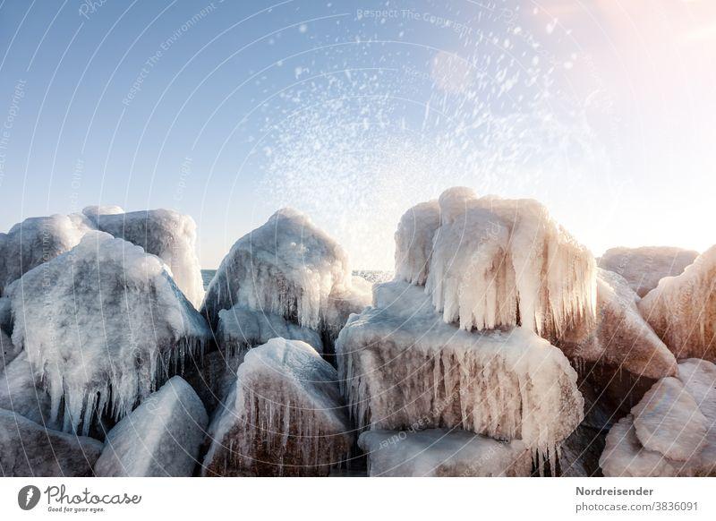 Mole of Saßnitz with icicle in winter Sassnitz Baltic Sea Rügen Winter Ice Ocean Water Frost White crest splash Icicle stones Break water breakwater Wild Wind