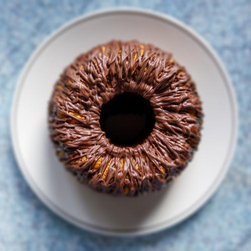 Cake on plate with chocolate icing in top view, weak depth of field from on high plan Baking Food Kitchen Self-made cute Fresh Blue Brown Eyes iris Square
