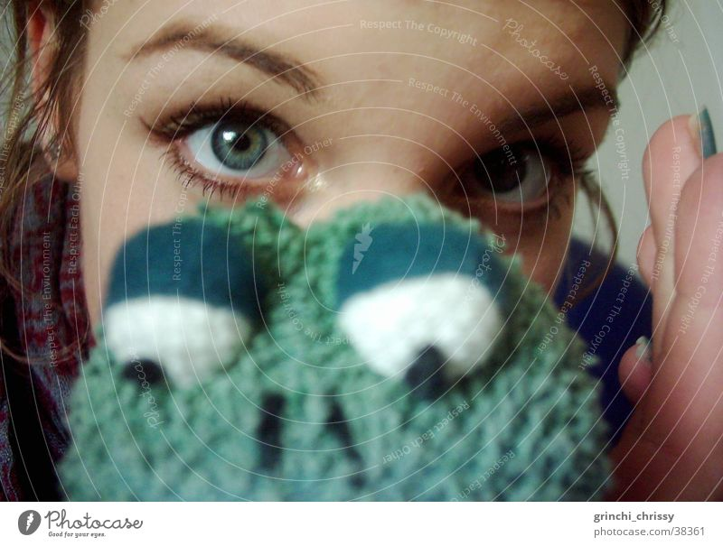 Woman Green Eyes Near Frog Eyebrow
