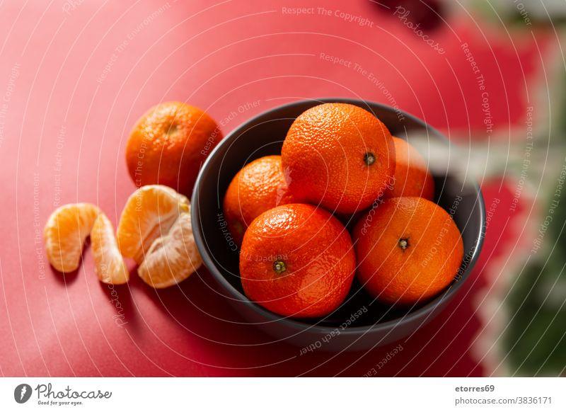 Fresh tangerines in bowl asian blue chinese citrus clementine food fresh fruit healthy isolated juice macro mandarin natural nature new year orange organic