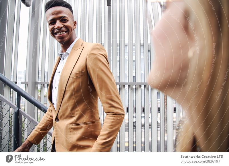 Young Businessman And Businesswoman Meeting Outside Office Building business businessman businesswoman airport office building commuter commuting meeting