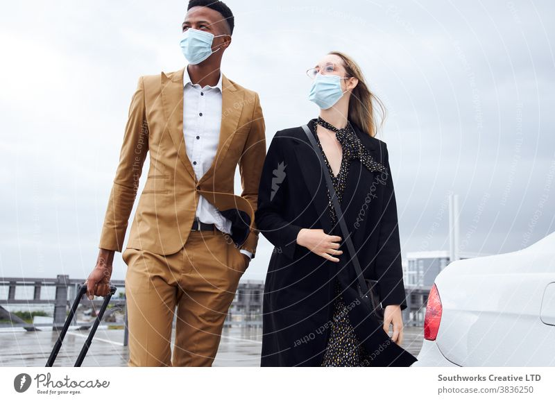 Business Couple Wearing Masks Outside Airport For Business Trip With Luggage During Health Pandemic business businessman businesswoman face mask face covering