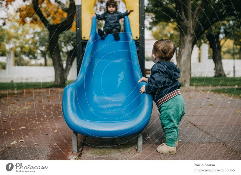 Brother and sister playing on the playground Brothers and sisters Caucasian Together Toddler togetherness Love Friendship Family & Relations Happiness 2