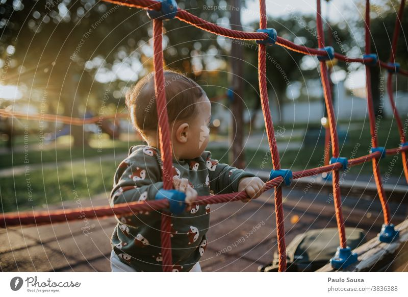 Toddler playing on the playground Caucasian 0 - 12 months Colour photo one person Baby Human being Day Small Cute Infancy Child Beautiful Happy Playing