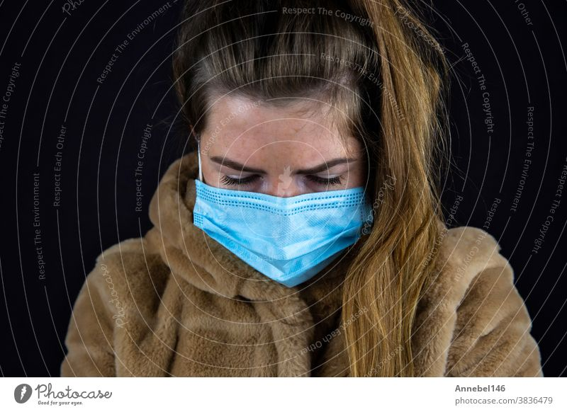 Portrait of a beautiful young woman wearing a winter jacket with medical mask for Coronavirus, Covid-19 concept person face portrait people girl lady female