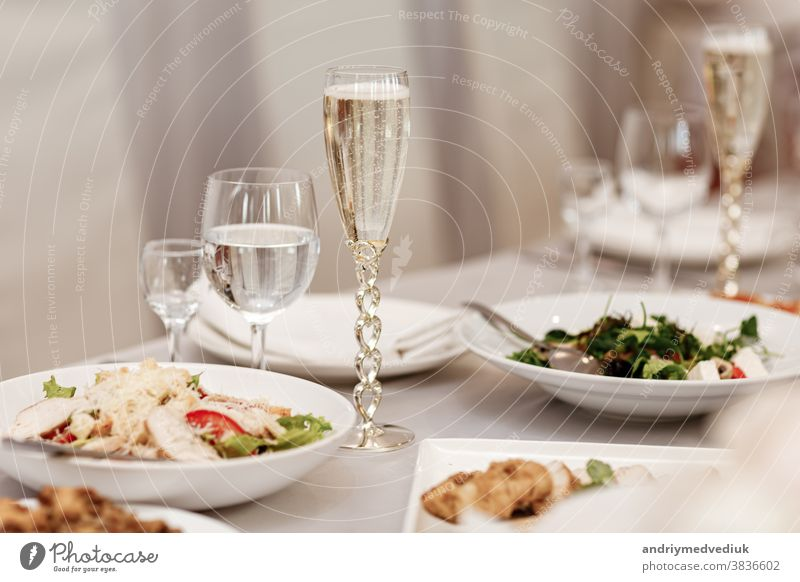 Serving table of a variety of delicious festive food and wine prepared for event party or wedding. selective focus. dinner setting celebration dining nobody