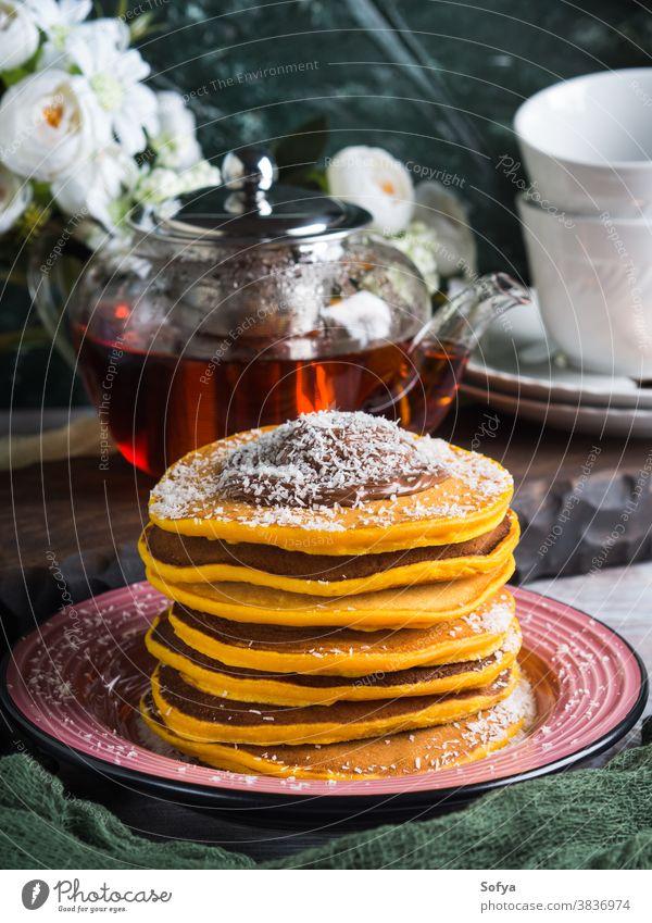 Pumpkin pancakes stack served with chocolate food pumpkin breakfast plate dessert honey brunch sweet tasty american gourmet maple meal morning syrup table