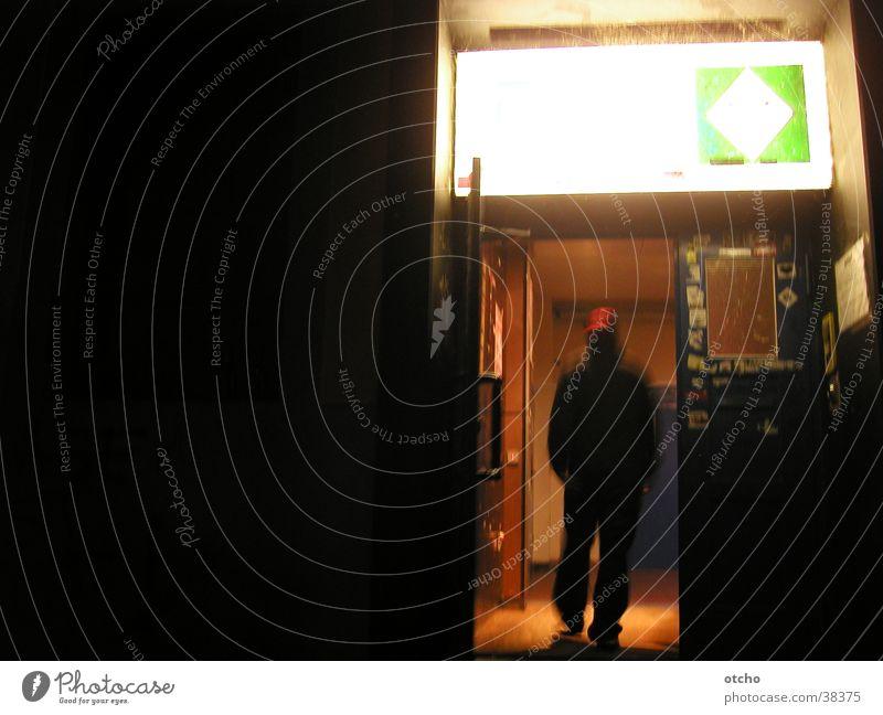 entrance at night Entrance Door Man Light Dark Club Open Baseball cap nothing going on