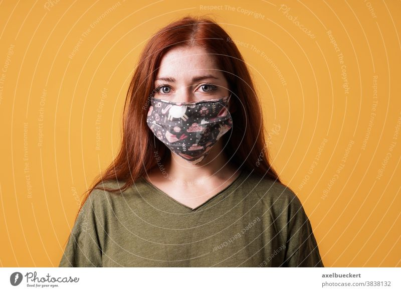 young woman wearing homemade cloth face mask or community mask everyday mask corona coronavirus covid-19 people hygiene health care portrait epidemic protection