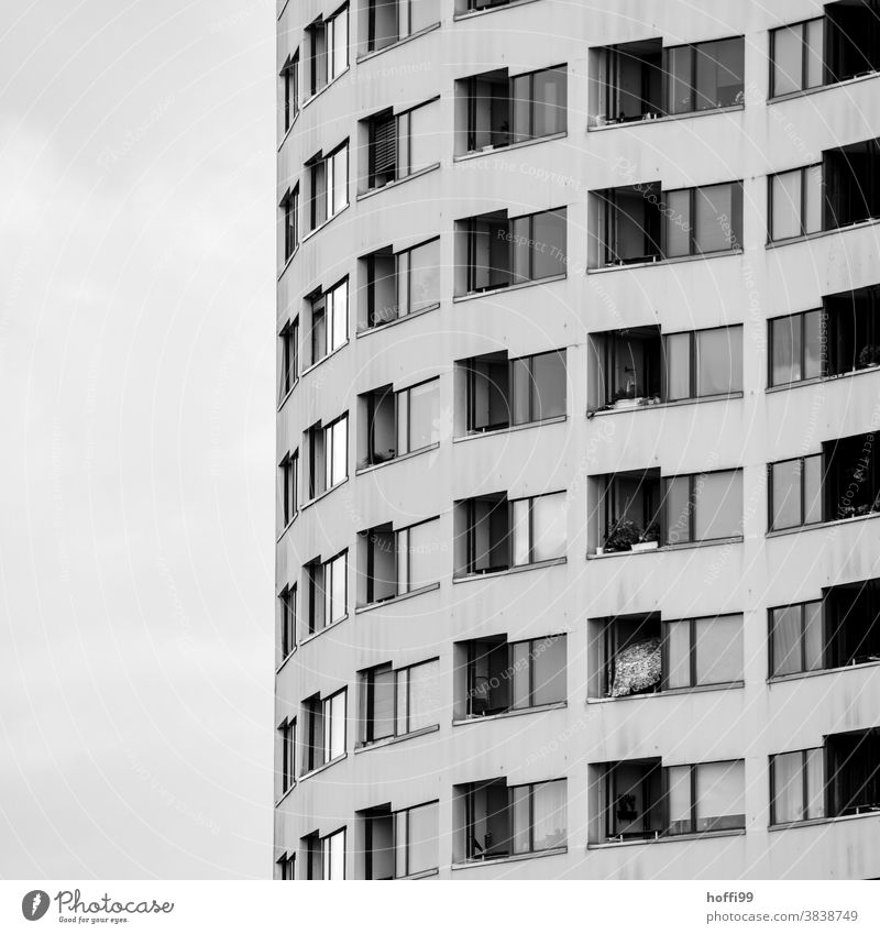Spiral-shaped windows and balconies wind their way up the dismal façade spirally Window Balcony Facade Glazed facade dreariness dwell block of flats High-rise