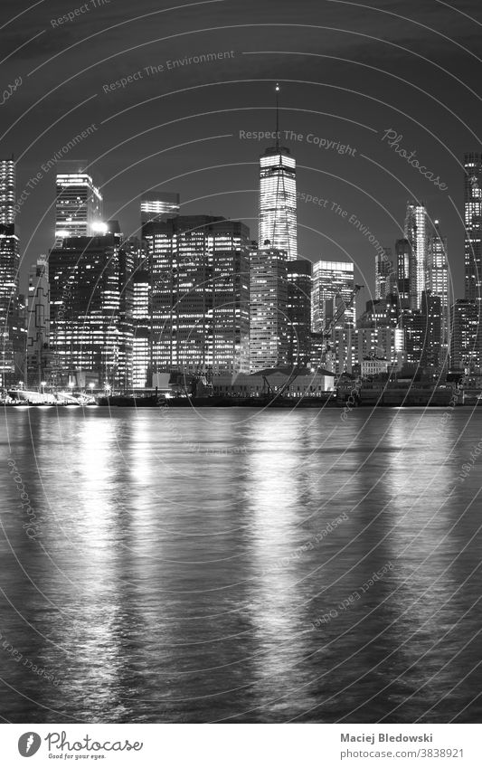 Black and white picture of New York cityscape at night, USA. NYC new york Manhattan black and white office skyscraper building apartment skyline river