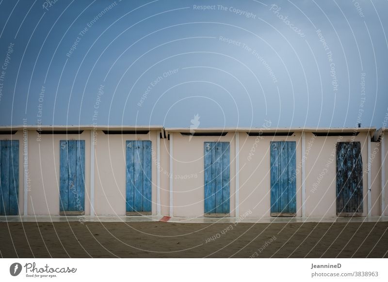 Autumn atmosphere, wet sand, changing rooms with blue doors Beach rainy day Empty Italy Deserted Bad weather Exterior shot Wet Rain Rimini Colour photo Nature