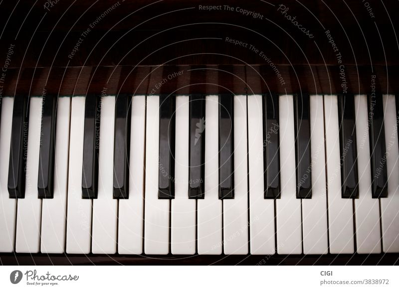 Black and white keys of a classical piano. aerial shot. keyboard musical black scale note instrument octave grand play harmony top sound musical scale acoustic