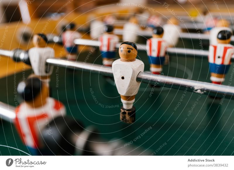 Vintage table football in room soccer game foosball retro vintage old fashioned player figurine nostalgia entertain tradition classic style wooden field green