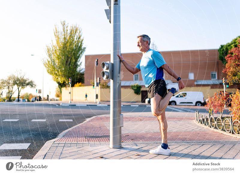 Retired senior man athlete stretching leg 58 rest rythm health care fitness high-blood-pressure training cardiac old neck rate caucasian check sport old man run