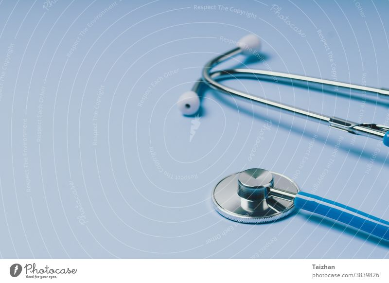 Close-up of Blue stethoscope of doctor for checkup on blue background cardiology disease exam health care medical concept equipment cardiac cardiologist colours